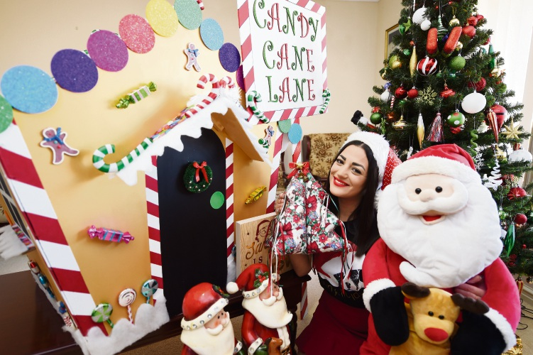 Sophie Nico's homemade Christmas pieces include a gingerbread house and colourful signs. Picture: Jon Hewson.