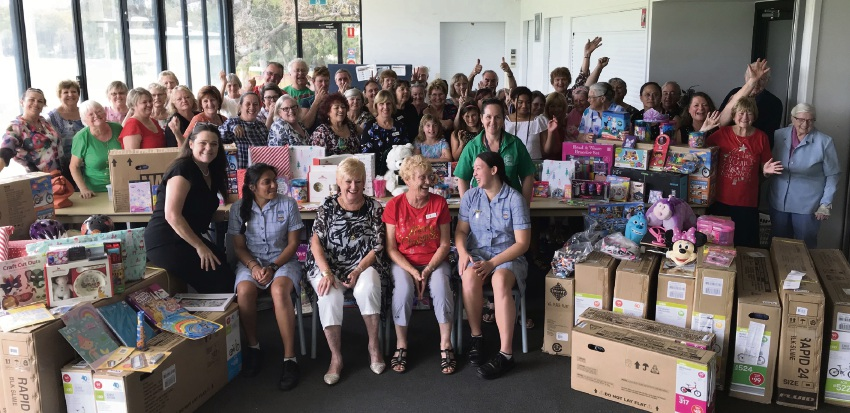 Mercy College's PaMaChi group donated $6000 worth of presents to Grandparents Rearing Grandchildren.