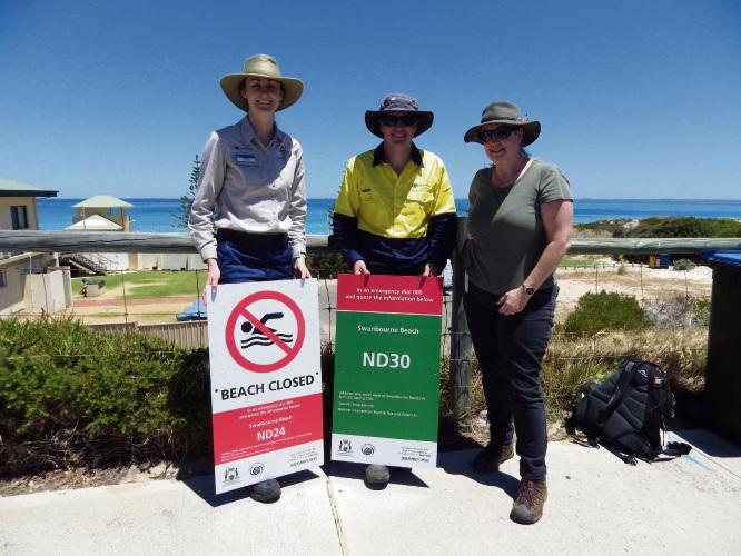 Nedlands ranger Jessica Bruce, parks supervisor Nathan Deery and Ben sign program coordinator Marion Massam with the sign at Swanbourne beach.