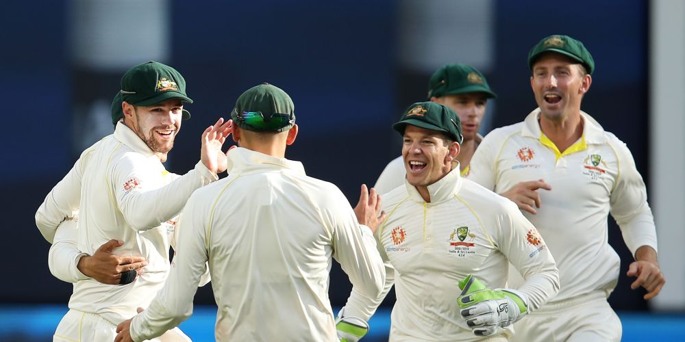 Australia's Travis Head celebrates catching Ajinkya Rahane of India off a delivery by team mate Josh Hazlewood on day four at Optus Stadium, Picture: Cameron Spencer/Getty Images