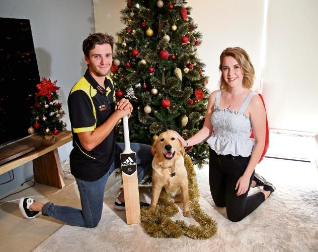 WA cricketer Jhye Richardson with his girlfriend Jess Moxham and their puppy Nala. Picture: David Baylis
