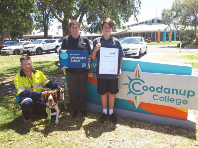 The Water Corporation's Andrew Blair with leak-detection dog Kep, principal Vicky McKeown and student Reece Lego.
