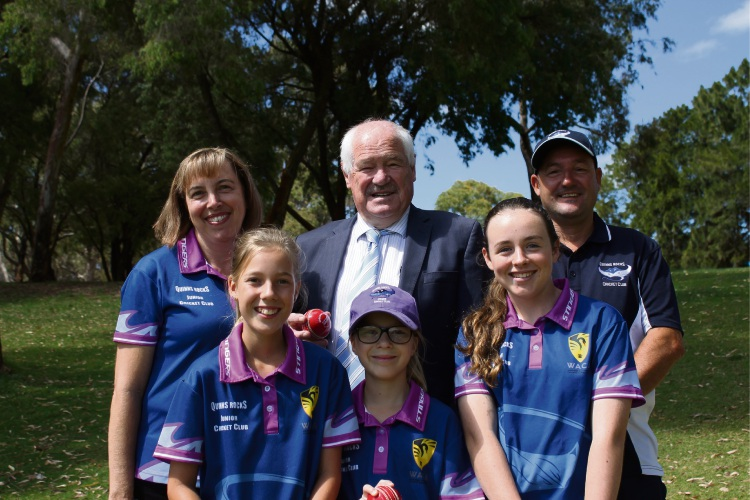 Sport and Recreation Minister Mick Murray launches the Every Club Hub alongside community sport volunteers Mandy Butterworth and Eddie Woolhead, with junior members of the Quinns Rocks Cricket Club Ava Woolhead, Holly Woolhead and Chloe Butterworth.