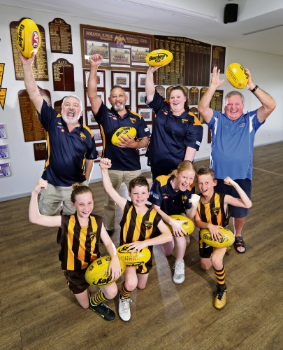 BACK L-R: Robert Credaro (Treasurer), Mark Micallef (President), Tegan Austic (Secretary) and Ken Perks (Inaugural Vice President).  FRONT L-R: Tayhla Austic (10), Riley Austic (9), Tegan Kennett (17) and Cody Kennett (9).  Noranda Hawks Football Club is celebrating its 40th anniversary in 2019. The club will be holding many events throughout 2019 to commemorate and celebrate the milestone. Picture: David Baylis www.communitypix.com.au