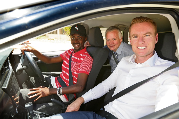Bienvenue Manirakiza (20) with Joondalup councillor John Logan and Mayor Albert Jacob. Picture: Martin Kennealey d489730