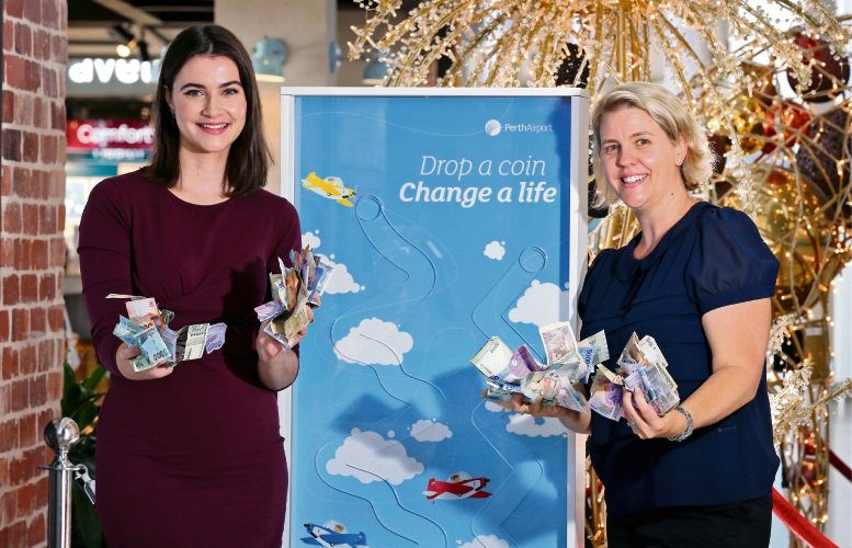 Lifeline WA's Megan Reynolds and Anna Dickie from Perth Airport collect some of the donations. Picture: David Baylis