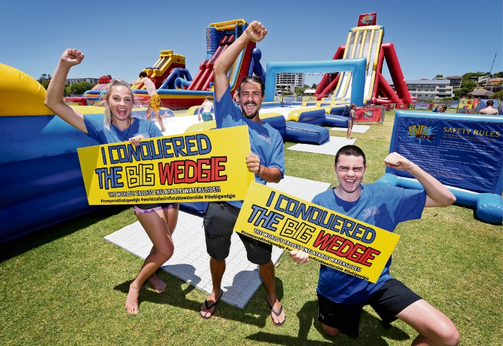 Staff at The Big Wedgie waterslide (L-R) Millie Dickenson, Bastien Lhoste and Xav Dumbill. Picture: David Baylis
