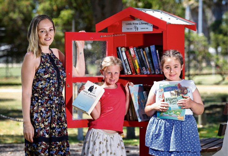 Cr Filomena Piffaretti (City of Bayswater) with Catherine Smith (7) of Noranda and Layla Piffaretti (7) of Noranda.  A handcrafted little library has been installed at McGilvray Oval in Noranda.  Designed and built by Bayswater Men's Shed. Picture: David Baylis www.communitypix.com.au   d489649