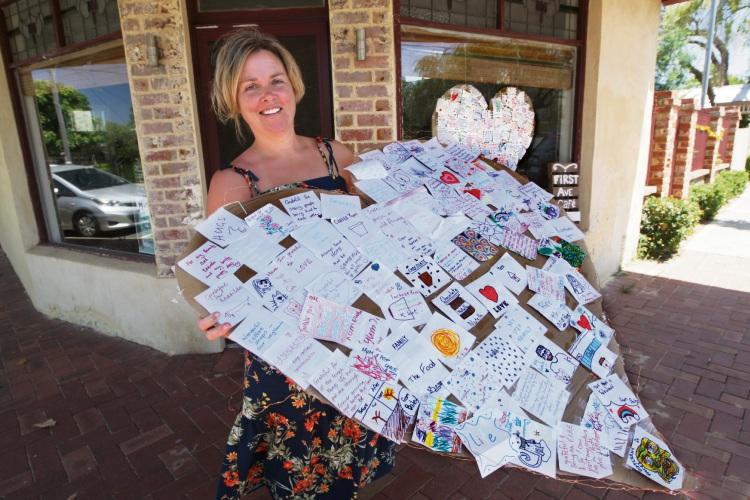 First Avenue café owner Marilyn Lewis with the two hearts made from notes of gratitude written by Kensington residents. Picture: Bruce Hunt
