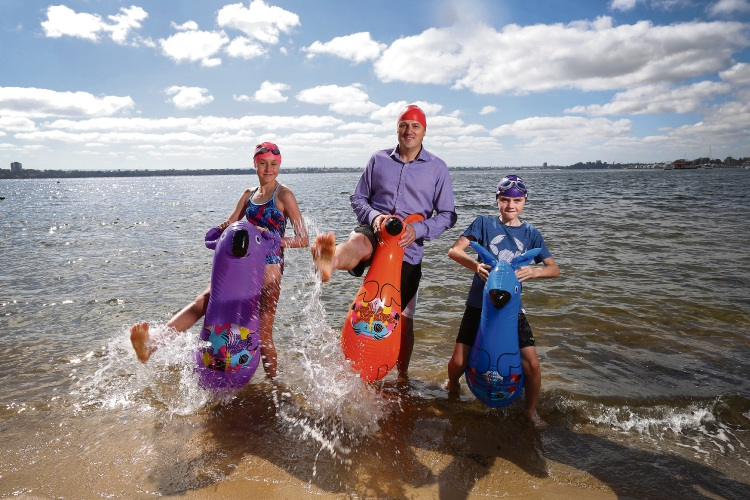 Telethon Speech and Hearing CEO Mark Fitzpatrick with young swimmers Paola Ion (11) and  Leo Ion (8) ahead of the Swim Thru Perth Picture: Andrew Ritchie www.communitypix.com.au   d489908