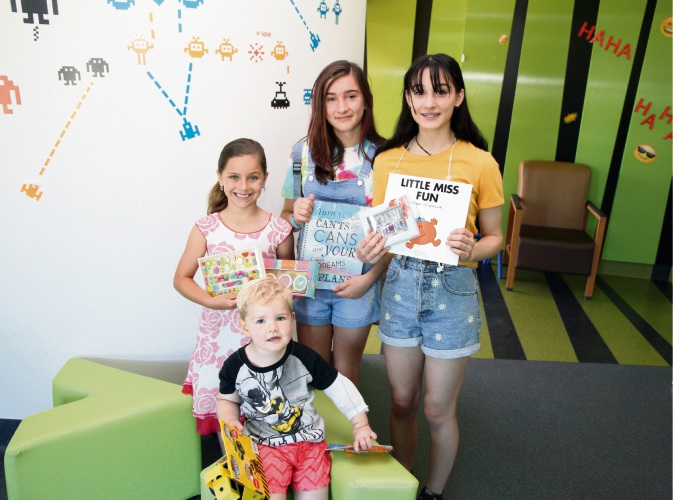 (L-R) Indi Cusato (8) and her cousins Caitlyn and Ebony with Fiona Stanley Hospital paediatric patient Max.