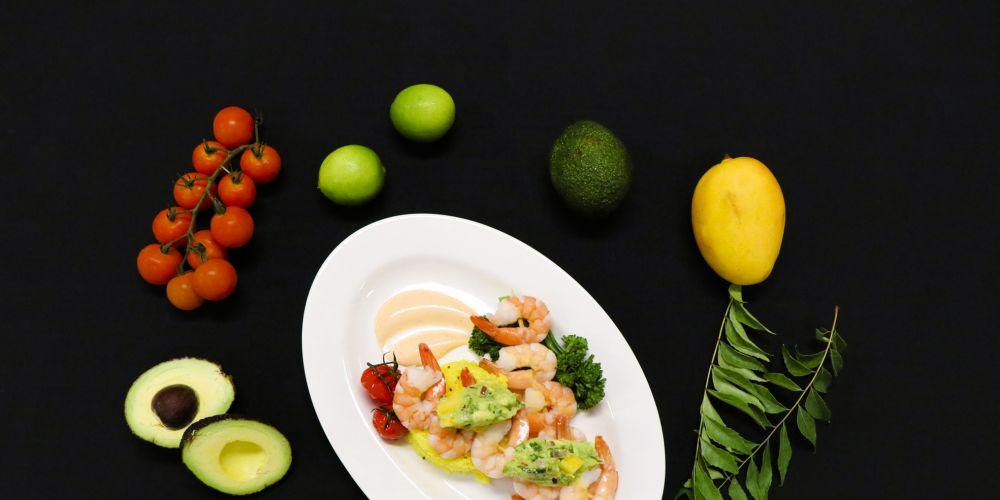 Grilled prawns with lemon rice and avocado mango salsa.