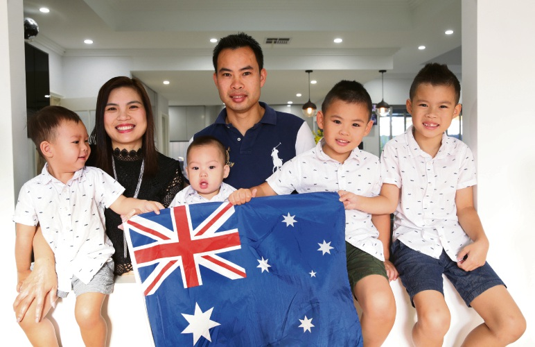 Thi Linh Hoang and Ngoc Do with their children Liam (2), Ryan (1), Philip (5) and Lucas (7).  Photos: Martin Kennealey