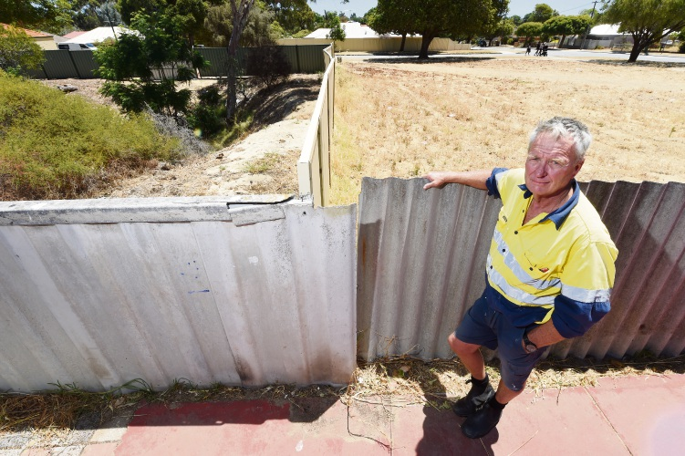 Denis Forkin is disgruntled that the Cit y of Melville will not help to replace a fence that borders council property. Picture: Jon Hewson.