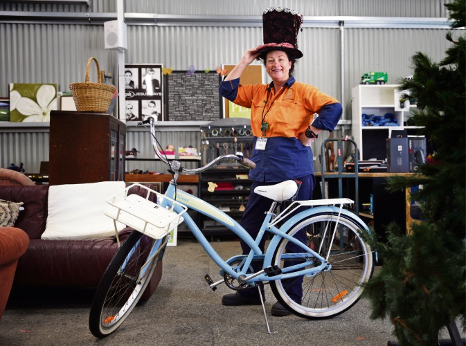 Mindarie Regional Council's customer service representative Andrea Bond shows off some of the items for sale in the Tamala Park re-use shop. Pictures: Martin Kennealey d490217