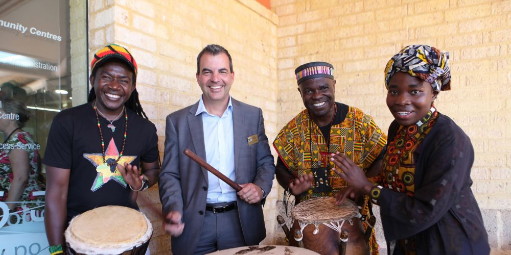 Stirling Mayor Mark Irwin drumming with Akwaaba members Paul Osei Kofi and Kawaka Nzige, and Bella Ndayikeze. Photo: Michael Gill