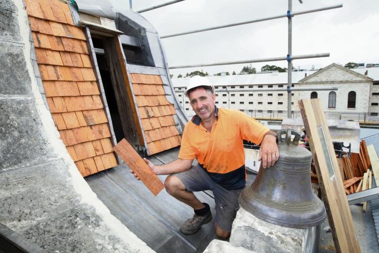 Michael Burdon helps fit a new shingle roof to the Fremantle Prison. Photo: Bruce Hunt. d490309 communitypix.com.au.