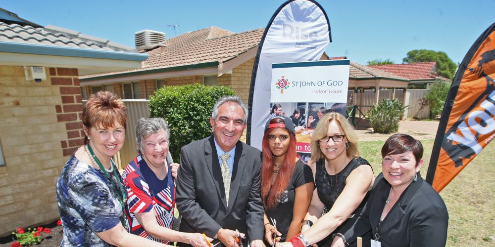 Mike Board (middle) officially opens Horizon House in 2014. Picture: Bruce Hunt