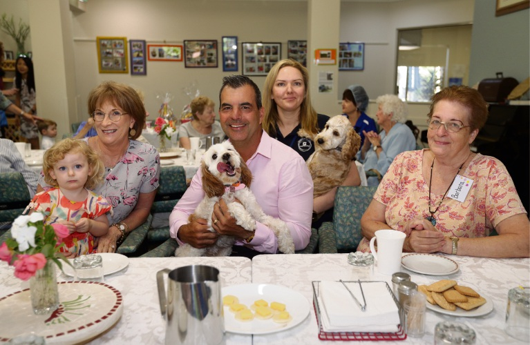 Alzheimer's WA chief executive Rhonda Parker, Violet Sujdovic (2), Stirling Mayor Mark Irwin with Poppy, Linda Kuuse (senior coordinator Day Club) with Cleo and Barbara Fisher. Photo: Martin Kennealey