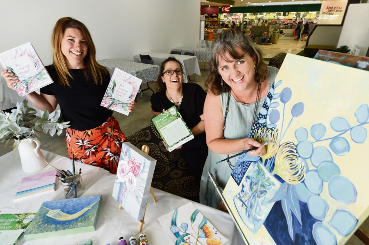 Stockland Bull Creek Shopping Centre manager Erica Campbell, marketing manager Kate Stagg and Mandurah artist Ashleigh Vincent. Picture: Jon Hewson