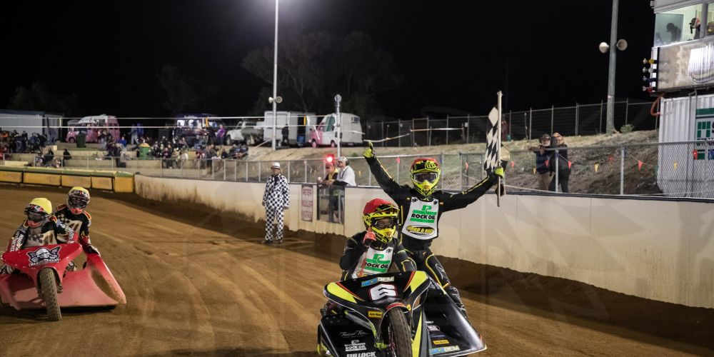 Reece Liptrott and Jesse Thomas celebrate with the chequered flag at Pinjar Park Motorcycle Speedway. Picture: Woza's Photography