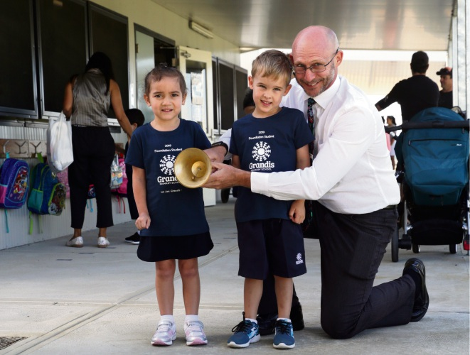 Principal Steve Bevan with Lola Ruru and Leo Arends (kindy). Photos: Martin Kennealey