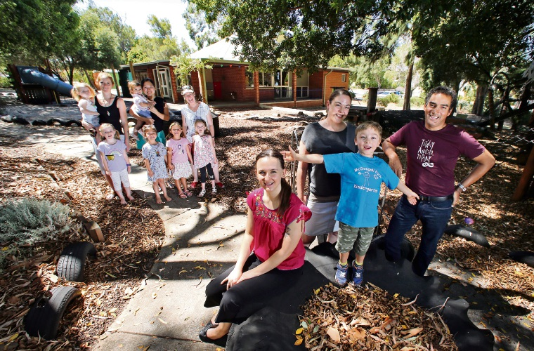 d490401aSG: FRONT: Teacher Evie Buckland, secretary Leonie Donovan with son Max (5), PMC Vice President Richard. BACK: Parents and children from the McDougall Park Community Kindy. Picture: David Baylis