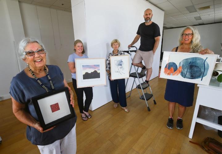 Swan River Print Studio members Annemie McAuliffe, Bethwyn Porter, Maggie Calzoni, Harvet Mullen and Jo Darvall with their work. Picture: Matt Jelonek