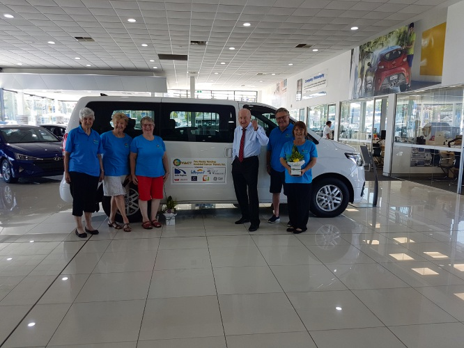 TRYACT volunteers collect their vehicle, registered as TRYACT 1, from John Hughes.
