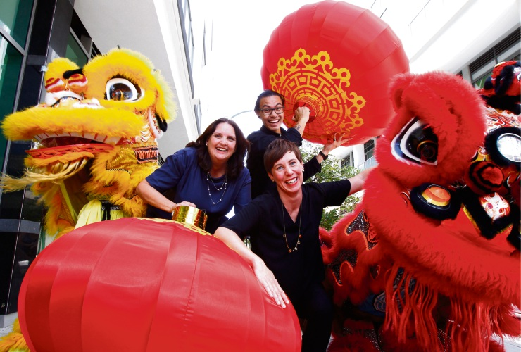 Johnny Doan (Northbridge Common Town Team), Emma Cole (right, Mayor City of Vincent) and Gaye McMath (City of Perth deputy chair commissioner) with performers from the Chinese Community Centre Lion Dance troupe getting ready for the Lunar New Year Lantern Festival Picture: Marie Nirme www.communitypix.com.au   d490630