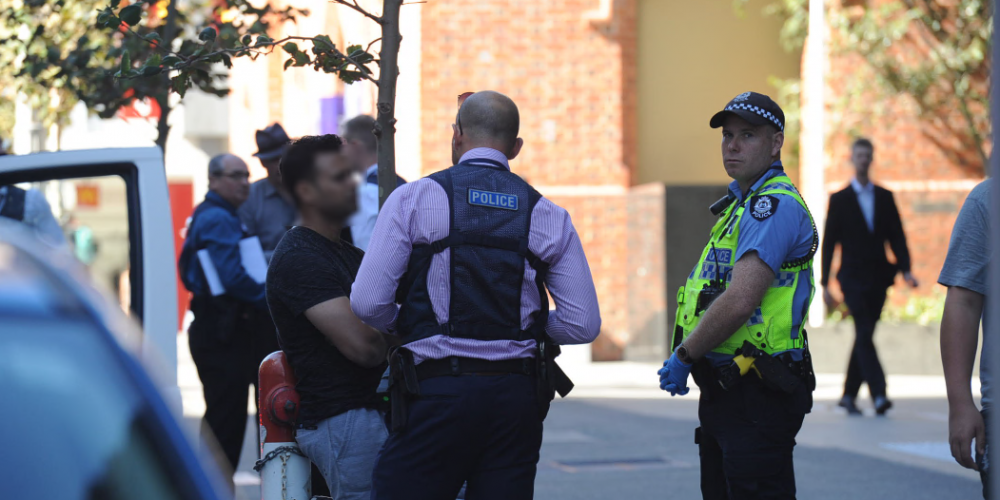 Detectives interviewing a suspect in Perth. Photo: Jon Bassett