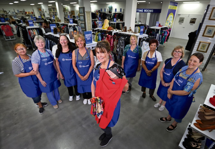 AT FRONT CENTRE: Sarah Needs (Retail Manager, Vinnies Kalamunda), surrounded by the volunteers that work in the new store. Photo: David Baylis