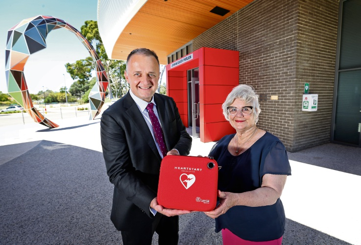 L-R: St John Ambulance Australia general manager Aaron and City of South Perth mayor Sue Doherty with a new exterior mounted defibrillator at John McGrath Pavilion, Ernest Johnson Reserve. Picture: David Baylis