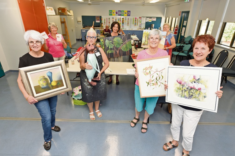 Willagee Community Art Group members Angela Massie, Lynnette Bell, Brenda Shilling and Annette Jacobs with their artworks. Picture: Jon Hewson