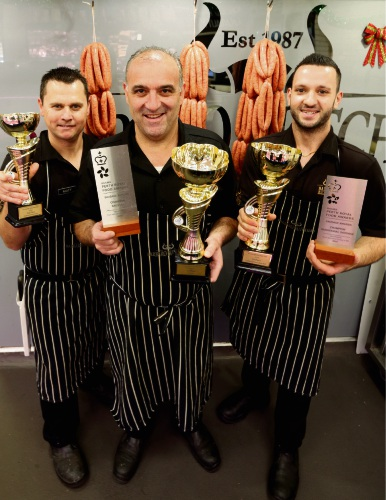 Butchers Matthew Bleyenberg, Raff Barbaro and Stefan Barbaro, of Barbaro Butchers in Greenwood, after winning the state round of the National Sausage King competition. Picture: Martin Kennealey d488885