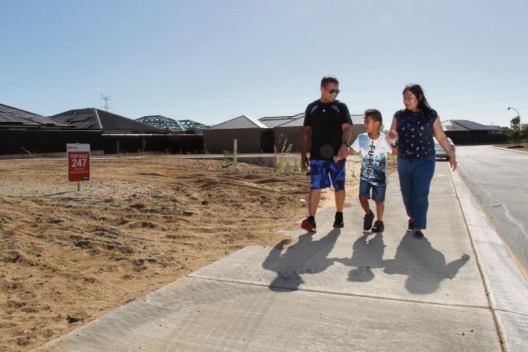 Lito, Keith (7) and Julieta Garces are looking forward to calling Movida home.