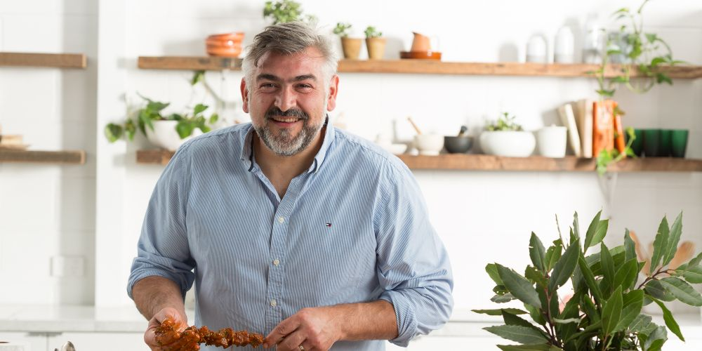 Chef Frank Camorra plates up his beef skewers