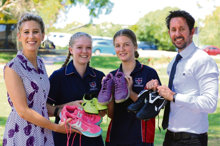St Stephen's School staff Natalie Everett and Adam Merrifield and Year 10 students Shanii Forrest and Emma Cooke are leading the Boot Drive.