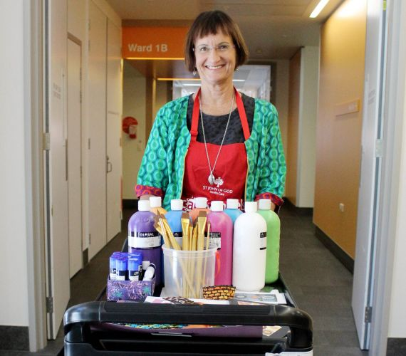 Andrea Day, arts and health project officer, with a cARTwheels trolley.