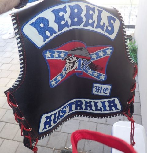 Rebels bikie charged over cash extortion claims