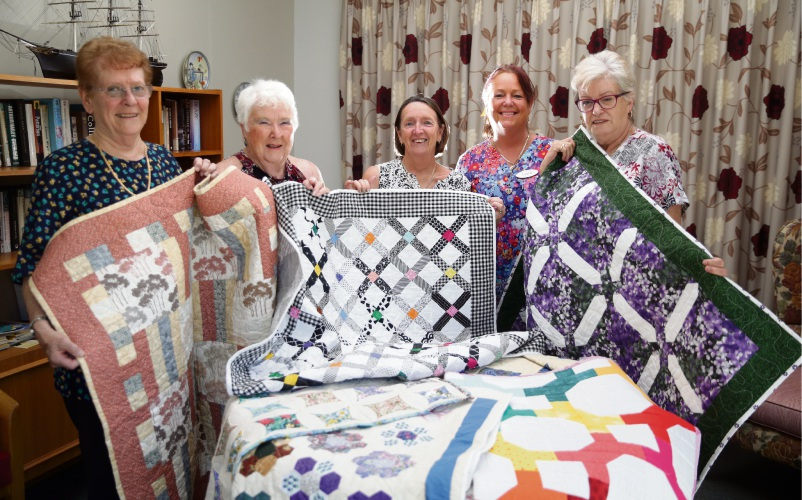 Wilma Poland, Marcia Dinnie and Katherine Chivers (The Scrappy Quilters) with OT assistants Laura Duffy and Margaret Hunter. Photo: Martin Kennealey
