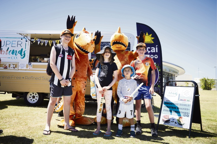 Perth Scorchers mascots Blaze and Amber with fans.