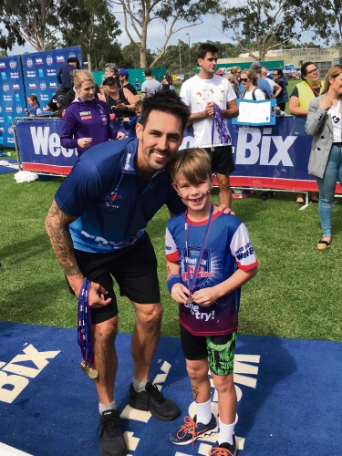 Hudson Hort (8), of Gwelup, with Mitchell Johnson at last year's TRYathlon