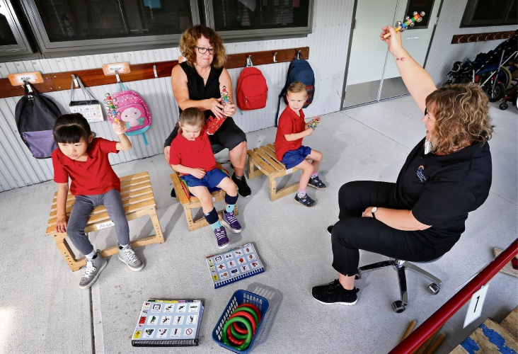 (L-R) Carson Street School students Alisa (Pre-Primary), Ava (Kindy), Lucie (Kindy) with education assistant Lucya Weiland and Conductive Education coordinator Shona Ballantyne. Picture: David Baylis