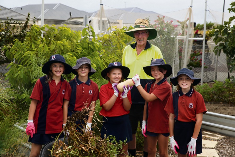 Brighton Community Garden Education and Resource Centre president Bernard Terry with East Butler Primary students Ava, Bridie, Nevaeh, Olivia and Hayleigh.  Pictures: Martin Kennealey