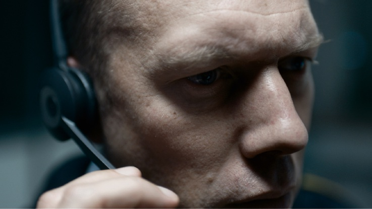 Jakob Cedergren as police officer Asger Holm in The Guilty.