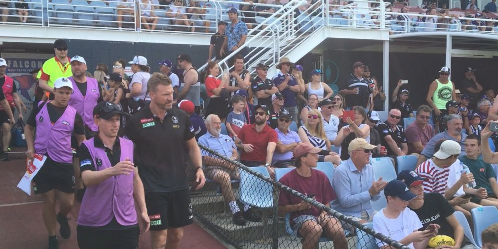Collingwood coach Nathan Buckley follows his players down the race at Joondalup Arena for the JLT Community Series match against Fremantle.