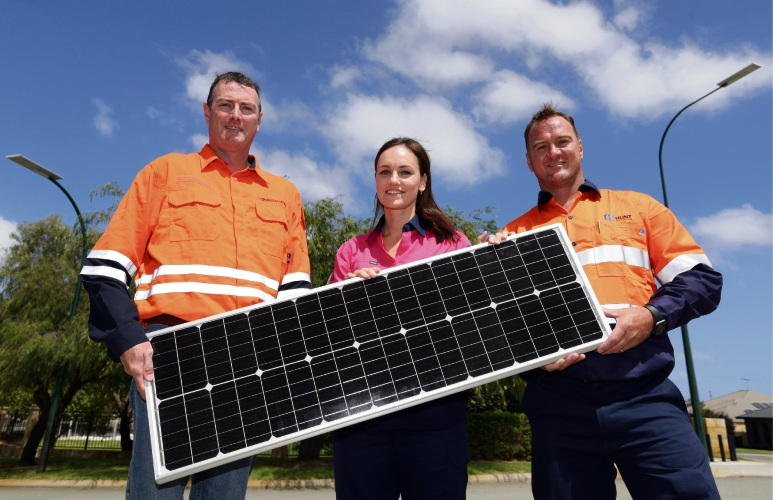Zane Christmas (Western Power) with Ashleigh Dover and Andrew Hunt from Hunt Solutions with a solar led speedlight.  Photo: Martin Kennealey