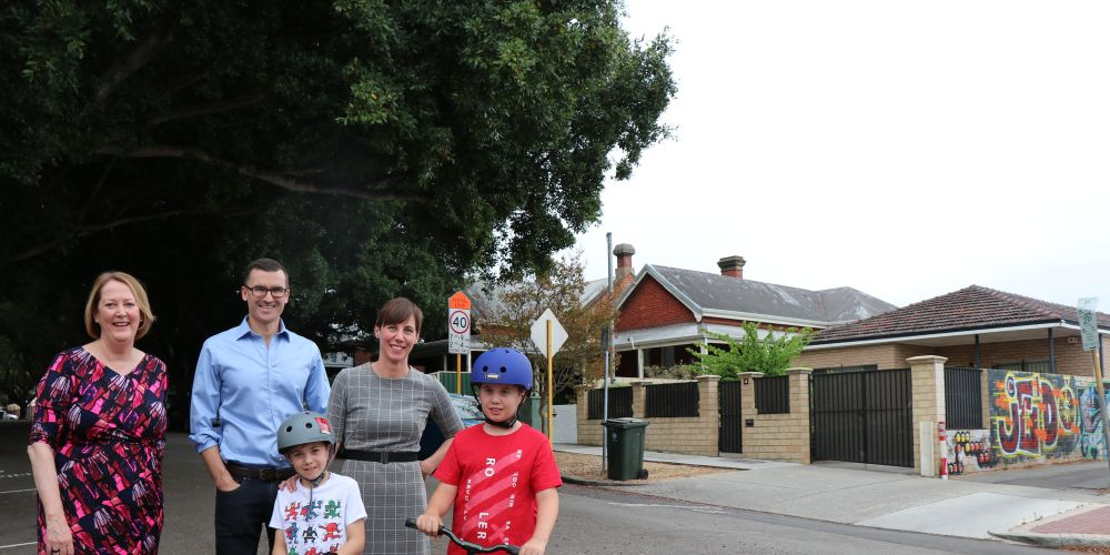 Minister for Road Safety Michelle Roberts, Perth MLA John Carey and City of Vincent mayor Emma Cole with her two children on Mary Street, Mt Lawley where the speed limit will be reduced to 40km/h