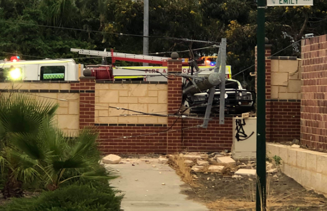 A car crashed into a power pole and wall on Wanneroo Road. Picture: Eddie Win